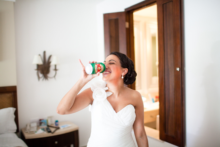 Destination Wedding Photographer in Toronto : bride enjoying a beer