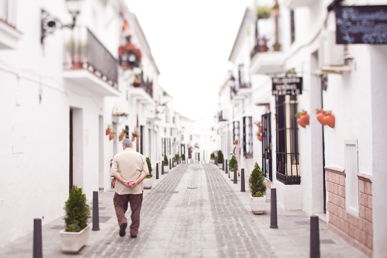 Toronto Photographer : old man taking a stroll on street in Mijas, Spain