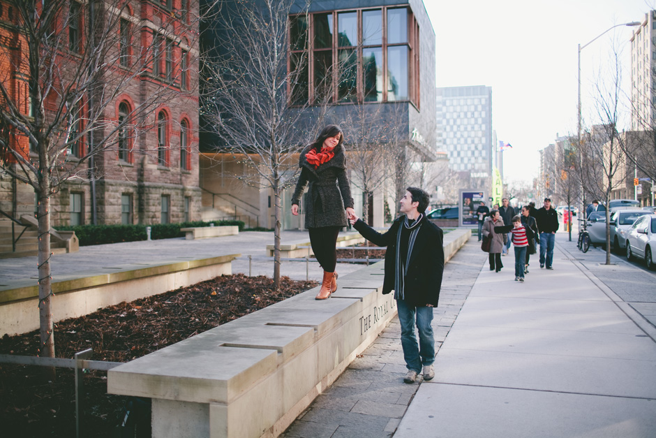 Photojournalistic Engagement Photography in Toronto : couple walking together on Bloor Street