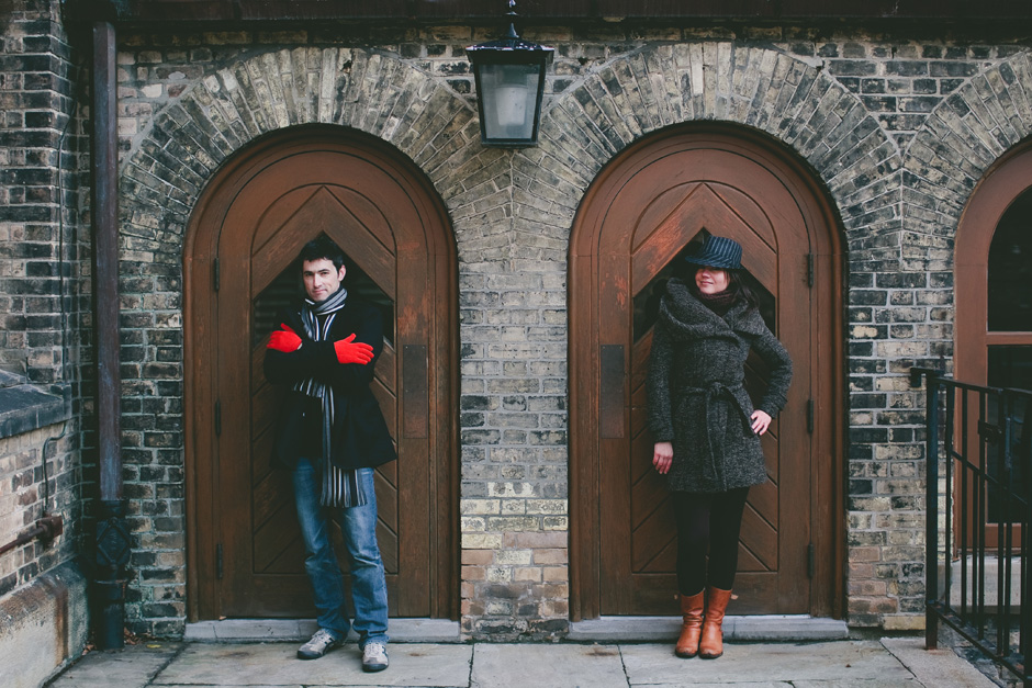 Creative Engagement Photographer in Toronto : couple posing by brown doors
