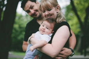 Toronto Family Photographer : baby and parents looking at camera in park