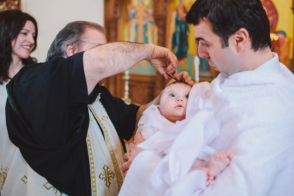 Cutting off a lock of hair at Greek Orthodox Baptism