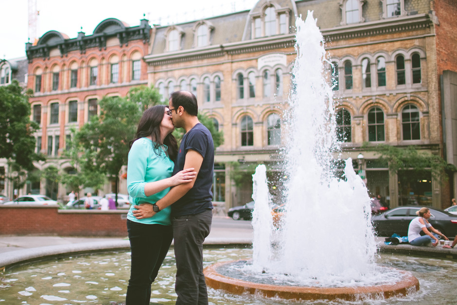 Toronto Engagement Photographers couple kissing by fountain